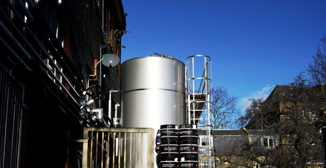 A view of the tanks and kegs outside The Five Points brewery near Hackney Central in London