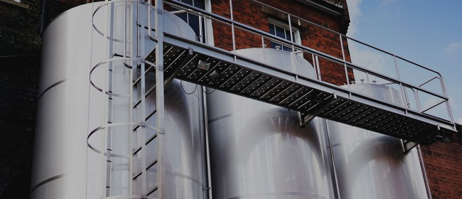 The outside fermentation vessels at The Five Points Brewing Company