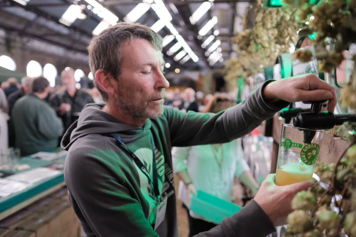 A man pouring a pint of beer at theKent Green Hop Festival